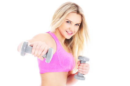 A picture of a young pretty woman exercising over white background